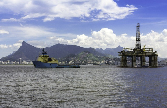 An oil rig being towed against the against panorama of Rio De Janeiro. Image (c) S