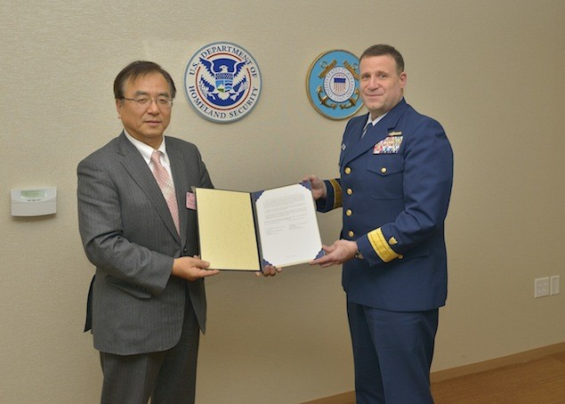 ClassNK Executive Vice President Dr. Takuya Yoneya receives a copy of the Recognized Organization Agreement from U.S. Coast Guard Rear Admiral Joseph A. Servidio while at USCG headquarters in Washington, D.C. on January 7, 2013. Photo: ClassNK