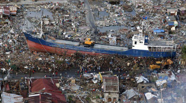 was swept by Typhoon Haiyan nearly two weeks ago, in downtown Tacloban city in central Philippines November 21, 2013. REUTERS/Erik De Castro