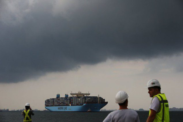 The world's largest container ship, the MV Maersk Mc-Kinney Moller, is led by pilot ships as it makes its maiden port of call at a PSA International port terminal in Singapore September 27, 2013. REUTERS/Edgar Su