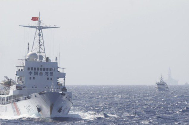 Chinese Coast Guard ships are seen near Chinese oil rig Haiyang Shi You 981 in the South China Sea, about 210 km (130 miles) off shore of Vietnam May 14, 2014. REUTERS/Nguyen Minh