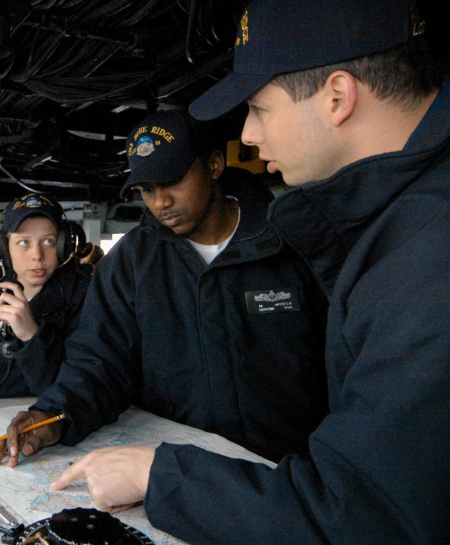 Lt. Cmdr. Aruffo (RIGHT) aids the Sea and Anchor navigation team on board the 7th fleet command ship Blue Ridge in 2006. U.S. Navy photo by Journalist Seaman Marc Rockwell-Pate