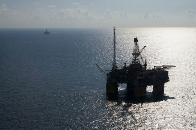 Aerial view of the Auger Tension Leg Platform in the deep-water US Gulf of Mexico in foreground. Noble Jim Thompson drilling rig in background. Photo (c) Royal Dutch Shell via Flickr