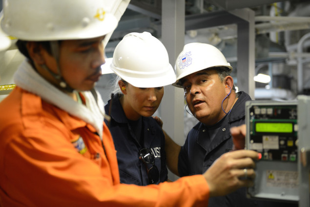 Tim Wilcox and Petty Officer 2nd Class Cindy Washburn, port state control officers at Coast Guard Sector Honolulu Prevention, conduct an inspection of the engine room aboard the 600-foot Panamanian-flagged bulk freight ship Teizan, at Kalaeloa Barbers Point Harbor, May 19, 2015. Coast Guard crew members conduct inspections to ensure a vessel has a suitable structure, correct documentation, proper working equipment and lifesaving equipment, and adequate accommodations. (U.S. Coast Guard photo by Petty Officer 2nd Class Tara Molle)