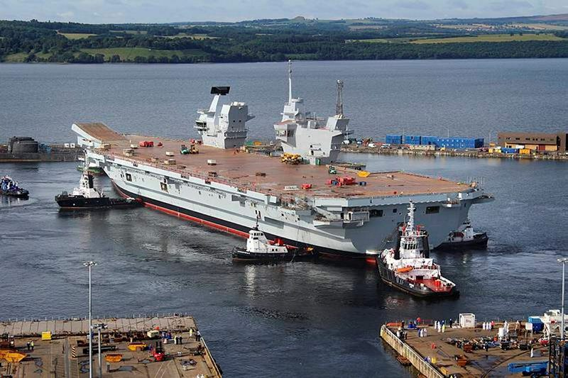 The Royal Navy's largest ever warship HMS Queen Elizabeth is gently floated out of her dock for the first time in Rosyth, Scotland in July 2014. Photo: UK Ministry of Defence