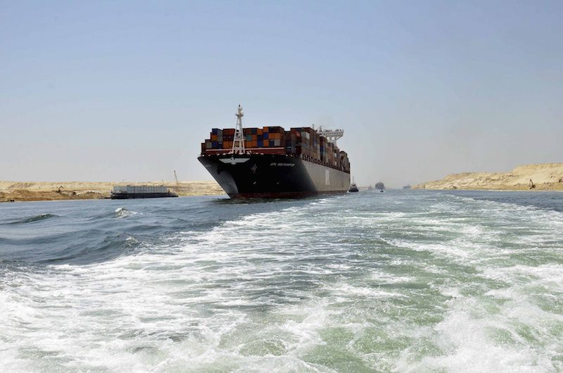 A cargo ship is seen crossing through the New Suez Canal during a test run held July 25, 2015. Photo: REUTERS/Stringer
