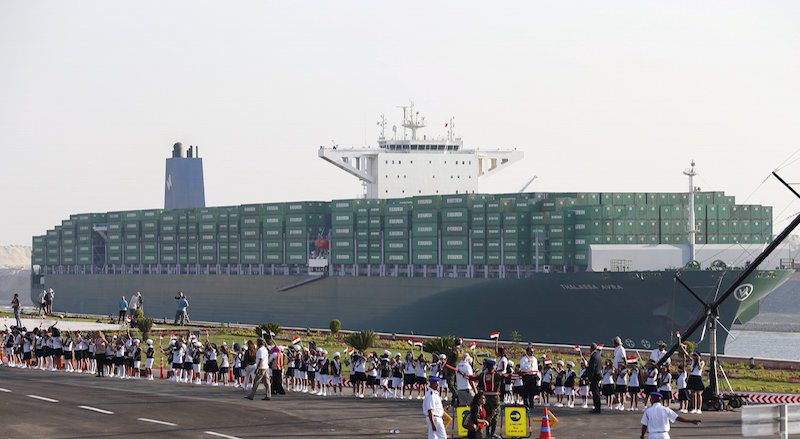 A cargo container ship crosses new section of Suez Canal after opening ceremony of new Suez Canal, in Ismailia