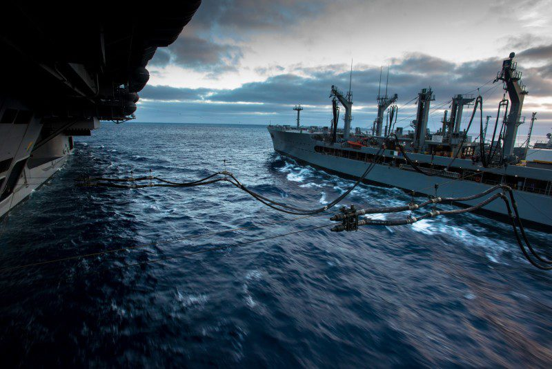 150731-N-IK337-017 PACIFIC OCEAN (July 31, 2015) The aircraft carrier USS John C. Stennis (CVN 74) connects fuel supply hoses from the Military Sealift Command fleet replenishment oiler USNS Henry J. Kaiser (T-AO 187). The John C. Stennis Strike Group is conducting a composite training unit exercise, the final step before being certified for deployment. (U.S. Navy photo by Mass Communication Specialist 3rd Class Christopher Frost/Released)
