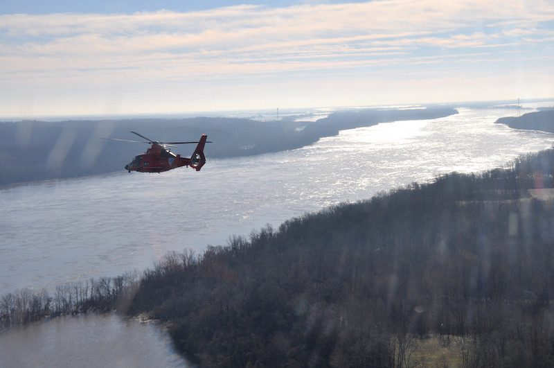 A Coast Guard MH-65 Dolphin helicopter crew surveys the region surrounding Cape Girardeau, Mo., located just south of St. Louis, as part a joint response to the Midwest Flooding, Jan. 3, 2016. U.S. Coast Guard Photo