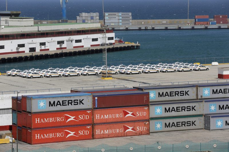 Shipping containers belonging to Hamburg Sud and Maersk companies are seen stacked at La Guaira port, in La Guaira, Venezuela, January 27, 2016. REUTERS/Marco Bello