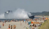 Russian Hovercraft Parks On Crowded Beach [VIDEO]